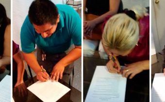 Firma de carta de compromiso para estudiantes becados